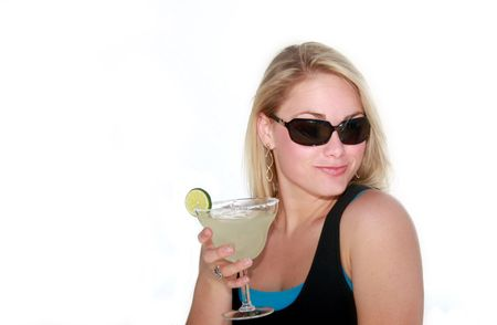 Pretty young blonde woman with sunglasses and margarita.