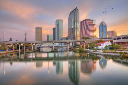 florida: Beautiful pink sunrise and reflections in downtown Tampa, Florida