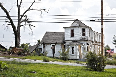 damaged roof: Residence a week after being struck by a tornado