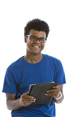 Handsome smiling young African American man holding electronic tablet standing in front of white background photo