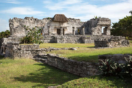 Mayan temple ruins with a thatched roof over a descending god fresco in Tulum, Quintana Roo, Yucatan peninsula, Mexico