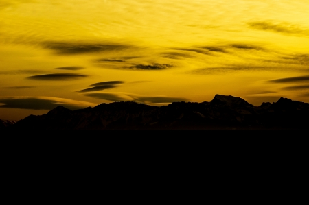 slightly: Black mountain silhouette with beautiful, slightly cloudy, colored sky