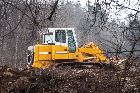 dredging tools: Parked construction caterpillar in the woods with detail shots
