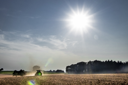 Tractor working in the field in the late afternoon Stock Photo - 21059772