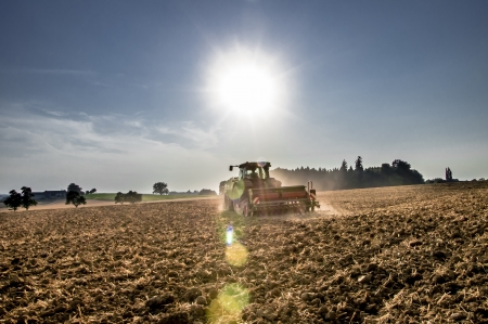 Tractor working in the field in the late afternoon Stock Photo - 21059777