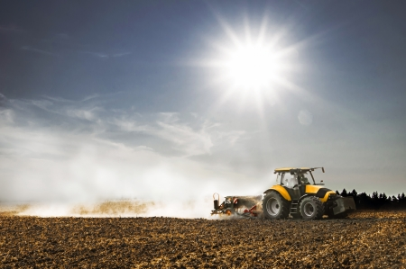 Tractor working in the field in the late afternoon Stock Photo - 21059787