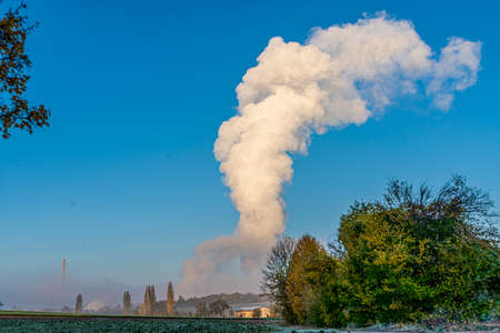 Cloud of steam over the cooling tower of a power plant Banco de Imagens