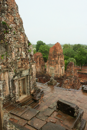 Sanctuary brick towers of the Pre Rup temple in Angkor, Cambodia. The central tower on the left. Stock Photo