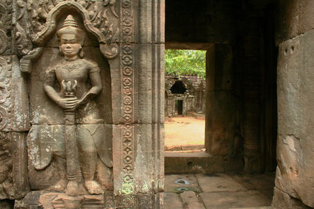 Entrance to inner sanctuary of Ta Som temple in ancient Angkor in Cambodia guarded by armed dvarapala, a temple guard. Stock Photo