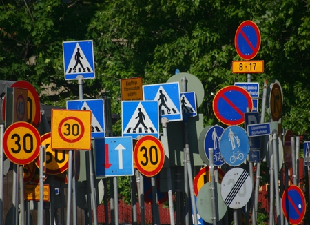 Lots of traffic signs in chaotic order Finland.
