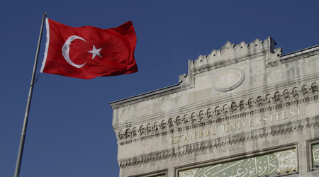 Flag of Turkey in front of the main entrance gate of Istanbul University. Stock Photo