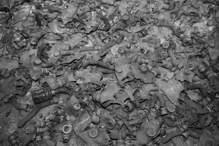 Gas masks  covering the floor of a abandoned building in Pripyat in Chernobyl Exclusion Zone, Ukraine. Stock Photo