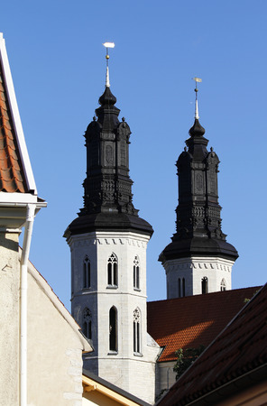 Towers of the Visby cathedral over the roof tops of medieval hanseatic town in Gotland Island, Sweden.