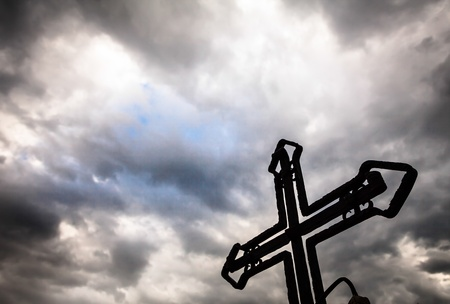 gloom: a cross in front of the sky to attract rain clouds, gloom