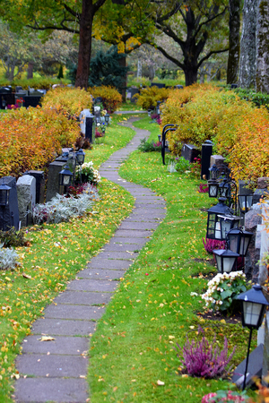 both sides: Path on cemetery. Tombstones on both sides of the path.