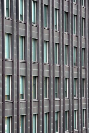 many windows: Exterior wall with many windows of multi-storey building. Stock Photo