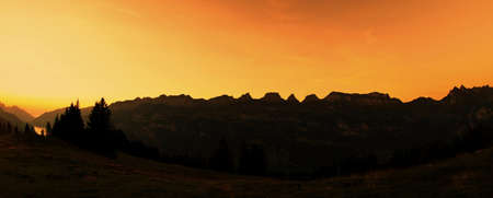 Beautiful orange sunset at mountains