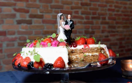 wedding cake: Wedding cake with strawberries over a table