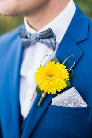Groom wearing blue suit Stock Photo