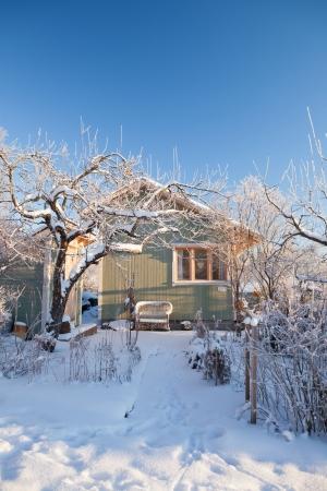 Summer cabin at winter. Clear blu sky.