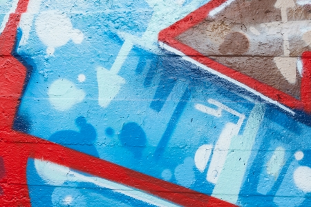 Graffiti closeup with arrows and blue dots photo