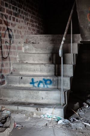 Creepy staircase in abandoned warehouse photo