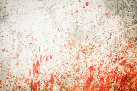 White concrete wall with blood splatters on the sides