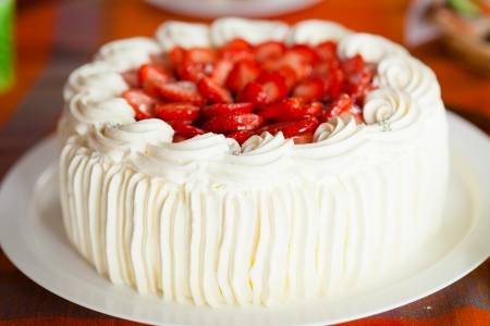 Delicious strawberry cake with strawberries and whipped cream Stock Photo