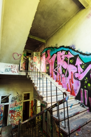 staircase from abandoned factory and graffiti photo