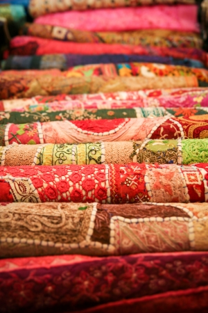 Folded pile of handmade textiles india photo