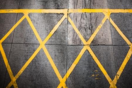 Grungy yellow road paint pattern photo