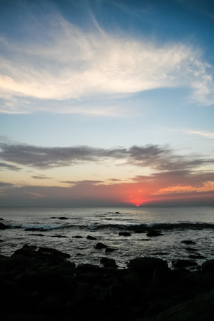 Calm sunset over ocean photo