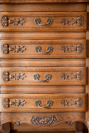 Antique wood carved chest of drawers photo