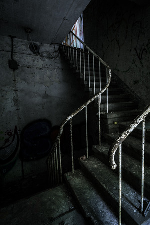 creepy hand: Horror staircase and hidden creepy hand Stock Photo