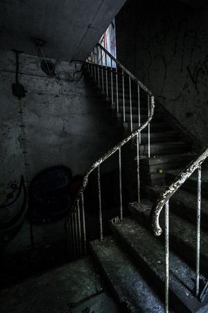 creepy hand: Horror staircase and hidden creepy hand Stock Photo