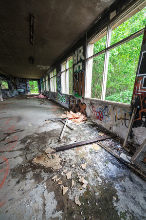 Abandoned factory hall and windows photo
