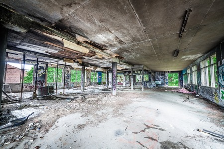 Messy old abandoned factory room photo