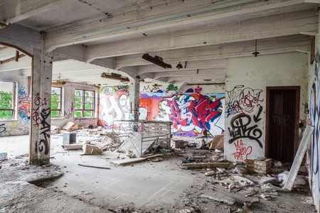 Messy abandoned factory room photo