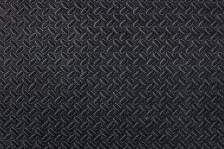 Dirty dark industrial grip floor texture pattern