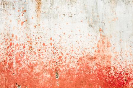 Betonnen muur met bloedspatten