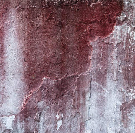 worn structure red: Broken concrete wall and faded red paint