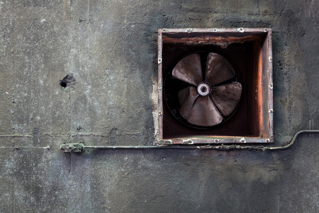 Abandoned air conditioning duct and rusted fan photo