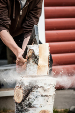 splitting up: Wood chopping with hand axe Stock Photo