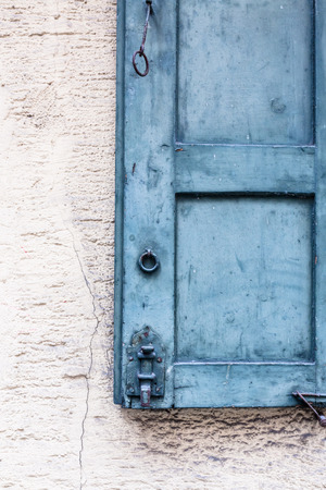 Old wooden window shutter details photo