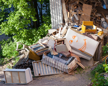 Funny broken furnitures trash pile