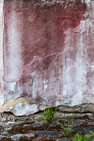 dint: Broken concrete wall and faded red paint