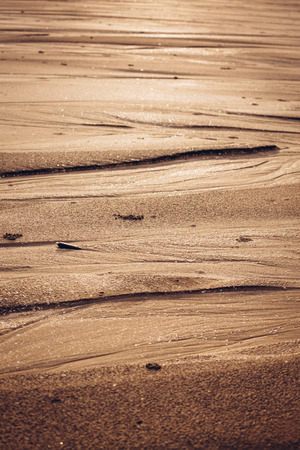 Natural sand patterns in beach photo