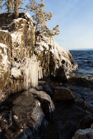 lakefront: Frozen lakefront rock cliff Stock Photo