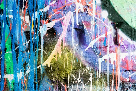 Dripping paint messy colorful graffiti wall closeup