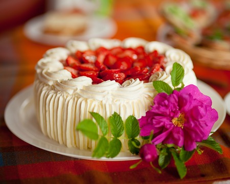 summery: Delicious summery strawberry cake on coffee table